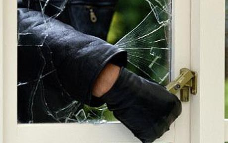 Thief Breaking Glass